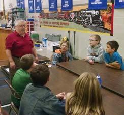 Monroe Environmental Engineer Dan Walch speaks to group of students