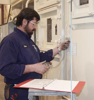 Technician performing equipment testing