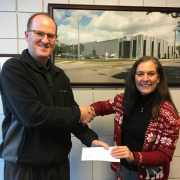 Monroe Environmental presents check to MCOP