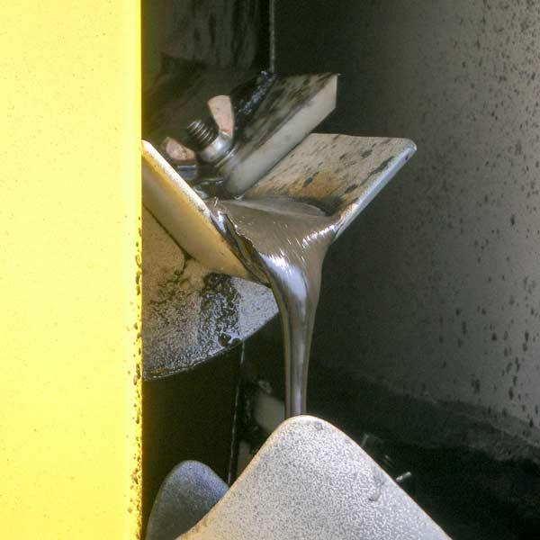 Monroe Oil Skimmer reclaiming condensed grease from venturi scrubber tank
