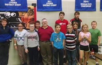 Monroe Environmental Engineer Dan Walch with group of students