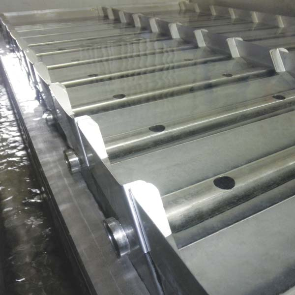 Parallel plate settlers greatly increase the effective settling area of existing clarifiers and sedimentation basins